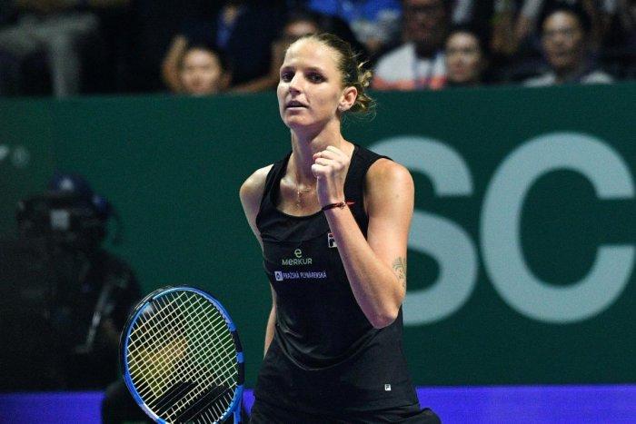 Czech Republic's Karolina Pliskova celebrates after defeating Denmark's Caroline Wozniacki during their women's singles match at the WTA Finals. AFP