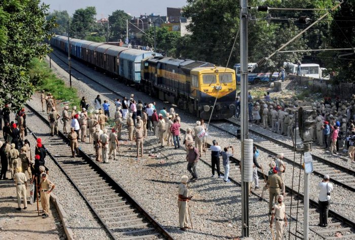 Security on high alert as the first train passes by before the resumption of railway services since the train accident in Amritsar on Sunday. PTI photo