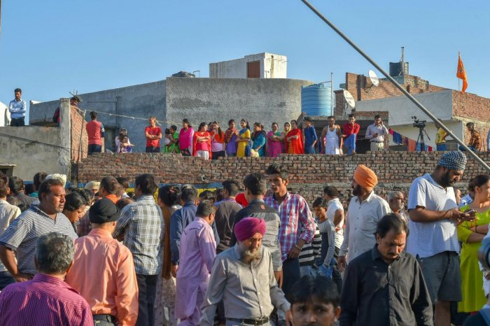 Locals gather near the train accident site at Jodh Phatak in Amritsar. PTI photo