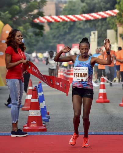 TRIUMPHANT: Ethiopia's Tsehay Gemechu crosses the finish line to win the Delhi Half Marathon title. PTI