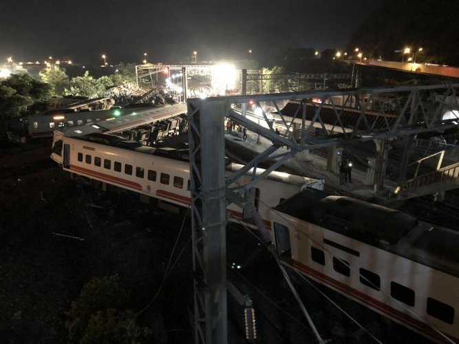 All of the train's eight carriages had derailed and five had flipped onto their side near Xinma station, the railways administration said, adding that 366 people were on board the service en route to the southern city of Taitung. AFP Photo