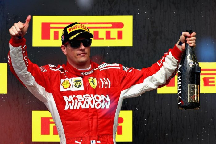 Race winner Kimi Raikkonen of Finland and Ferrari celebrates on the podium during the United States Formula One Grand Prix at Circuit of The Americas on Sunday, in Austin. (AFP)