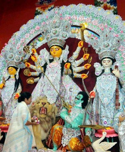 West Bengal Chief Minister Mamata Banerjee offering prayer during the inauguration of Goddess Durga Puja ahead of Durga Puja festival, in Kolkata. PTI file Photo