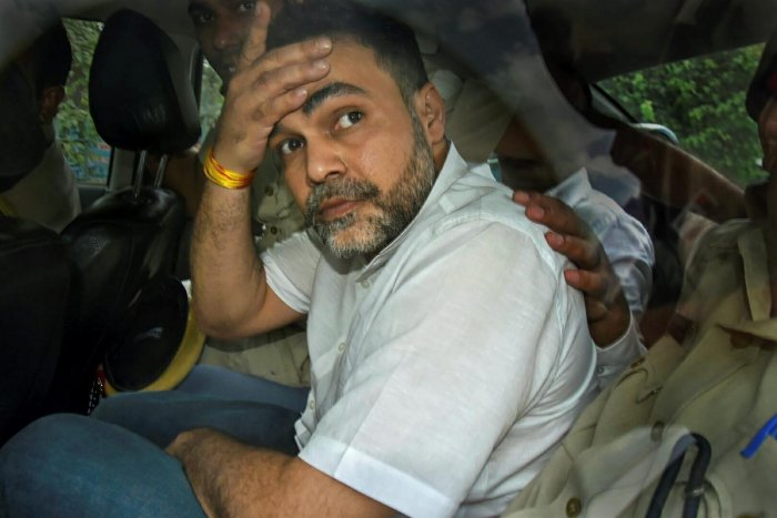 Ashish Pandey, accused of brandishing gun at guests outside a hotel, being brought out of the Patiala House Courts in New Delhi, Thursday, Oct 18, 2018. (PTI File Photo)