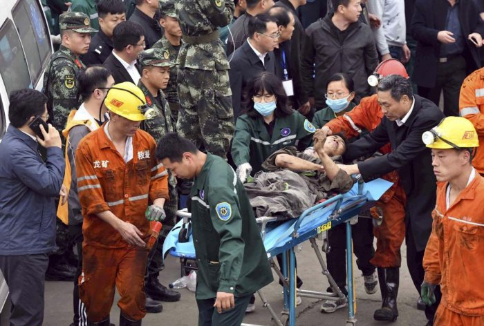 In this photo released by China's Xinhua News Agency, a worker is carried on a stretcher out of the Longyun coal mine in Yuncheng County, east China's Shandong Province on Sunday. AP/PTI
