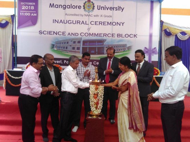 Central Sericultural Research Training Institute Mysuru, Director Dr V Sivaprasad inaugurates the new buildings of Science and Commerce blocks at Mangalore University PG centre in Chikkaluvara on Monday.
