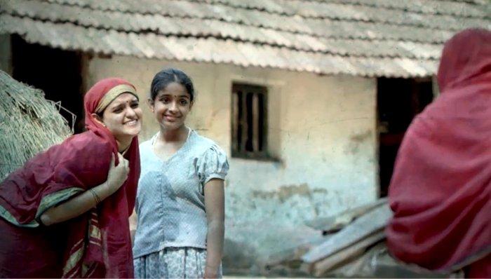 Vyjayanthi V Adiga and Diya Palakkal in a scene of Kannada movie 'Ammacchiyemba Nenapu'.