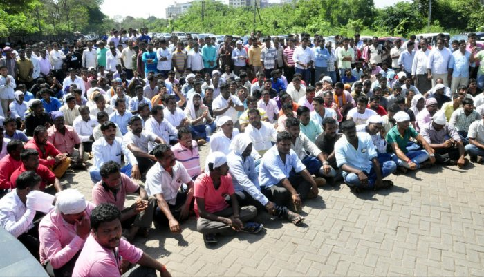 Udupi district Construction Materials Transport Vehicles Owners and Drivers Association members stage a protest in front of DC office in Manipal on Monday