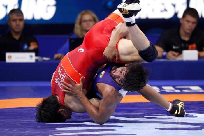 Japan's Takuto Otoguro (red) in action against India's Bajrang Punia on Monday. REUTERS