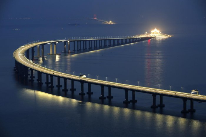 Hong Kong: The Hong Kong-Zhuhai-Macau Bridge is lit up in Hong Kong, Monday, Oct. 22, 2018. The bridge, the world's longest cross-sea project, which has a total length of 55 kilometers (34 miles), will have opening ceremony in Zhuhai on Oct. 23. AP/PTI(AP