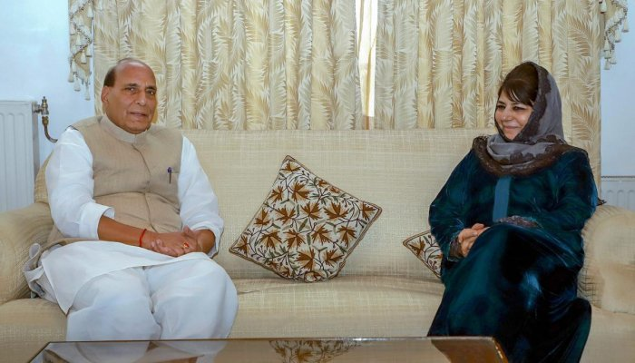 Union Home Minister Rajnath Singh with the President of the Jammu and Kashmir Peoples Democratic Party Mehbooba Mufti in Srinagar on Tuesday. PTI
