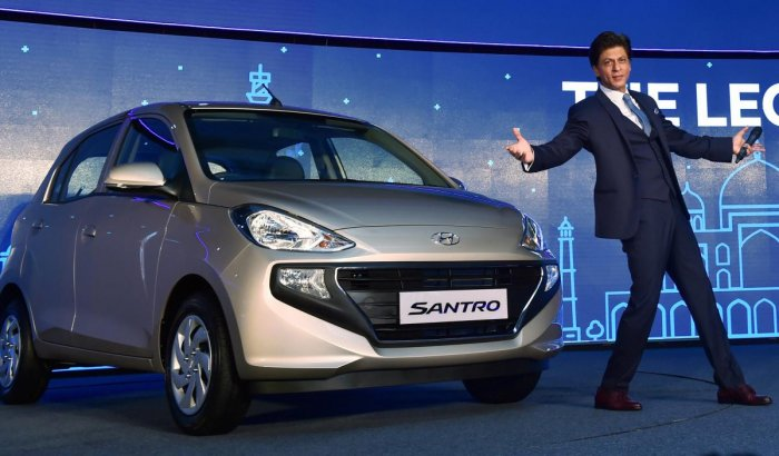 Bollywood actor & Hyundai brand ambassador Shah Rukh Khan poses for photos at the launch of the new Santro in New Delhi. PTI file photo