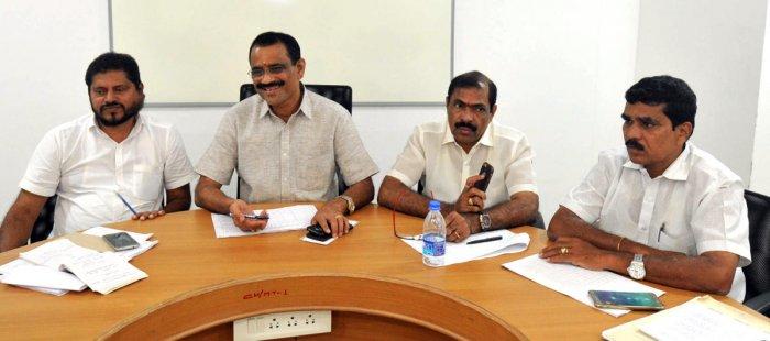 Mayor Bhaskar chairs a water adalat in Mangaluru on Monday.