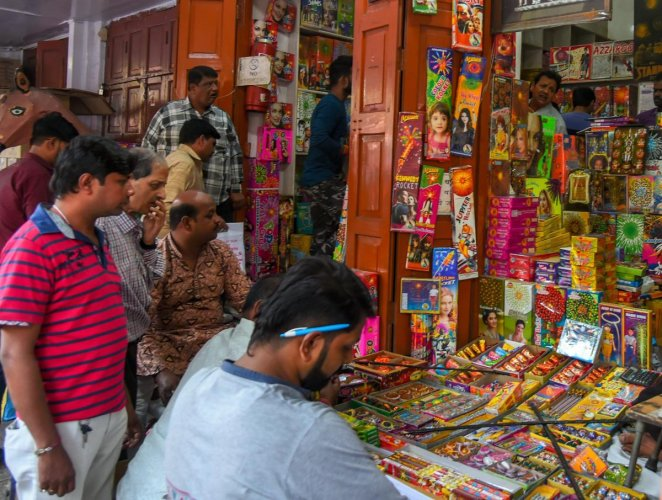 People purchase firecrackers in a market ahead of the festival of Diwali in New Delhi. PTI photo