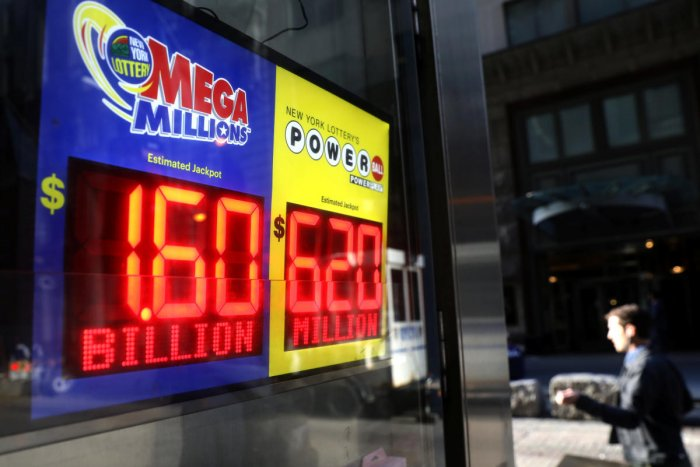 Signs display the jackpots for Tuesday's Mega Millions and Wednesday's Powerball lottery drawings in New York City. (Reuters photo)