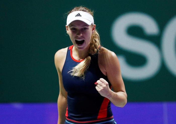 Denmark's Caroline Wozniacki celebrates after winning her group stage match against Czech Republic's Petra Kvitova. REUTERS