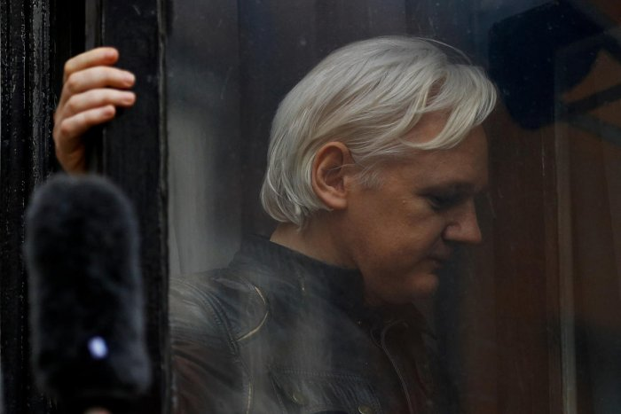 FILE PHOTO - WikiLeaks founder Julian Assange is seen on the balcony of the Ecuadorian Embassy in London, Britain, May 19, 2017. REUTERS/Peter Nicholls/File Photo