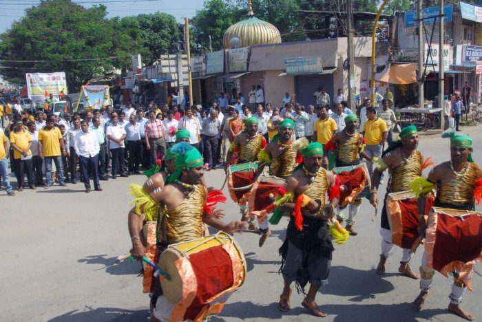 Folk artistes take part in a procession taken out as part of Valmiki Jayanti programme in Chikkamagaluru.