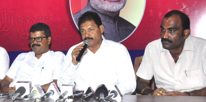 Udupi BJP district unit President Mattaru Rathnakar Hegde speaks to reporters on Wednesday.