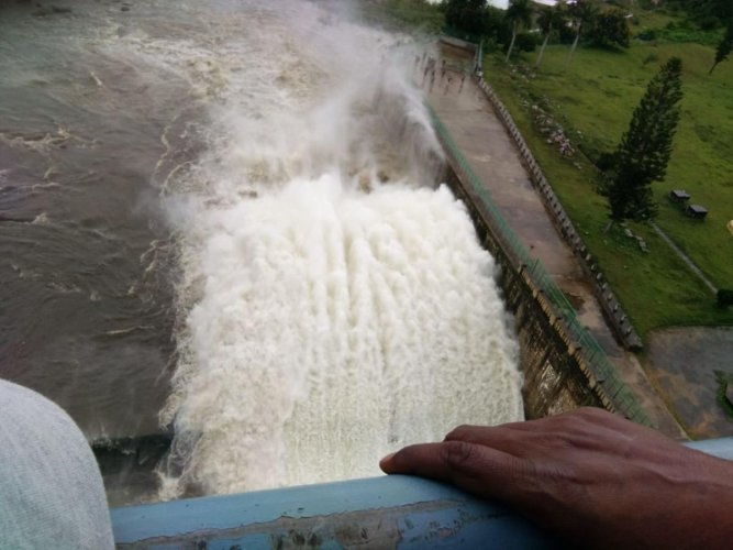 Water gushes out of a crest gate at Hemavathi reservoir at Gorur in Hassan district. Six crest gates were opened after the dam reached its full reservoir level on Saturday. (DH Photo)