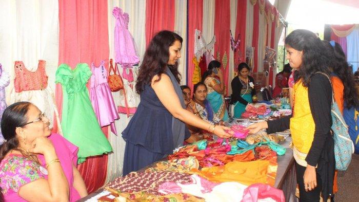 Micro-entrepreneurs display their products at 'Namodyami Sammelana' held at Deshpande Foundation in Hubballi on Monday.