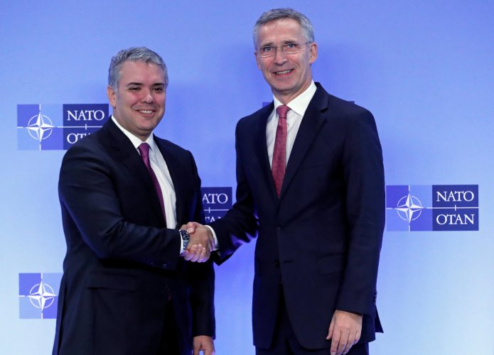 Colombian President Ivan Duque Marquez is welcomed by Nato Secretary General Jens Stoltenberg at the Alliance headquarters in Brussels, Belgium on October 23, 2018. Reuters