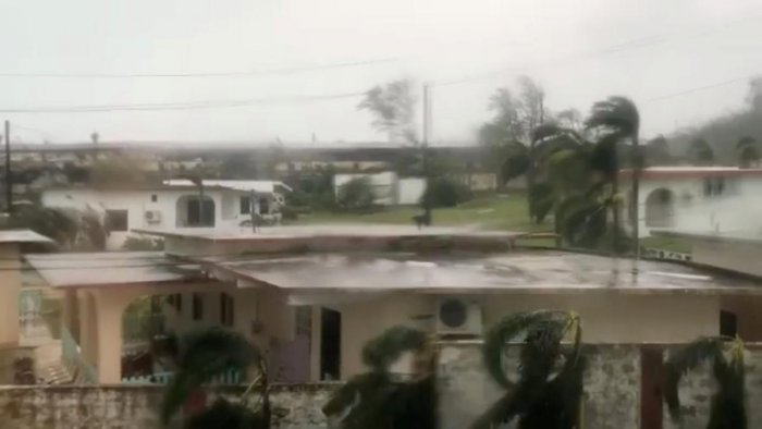 Trees sway during a storm as Super Typhoon Yutu descends upon Saipan, Northern Mariana Islands, U.S., October 25, 2018, in this still image taken from a video obtained from social media. @emmaninspn/via Reuters.