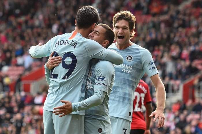 Chelsea's Alvaro Morata (left) celebrates with team-mates Eden Hazard (centre) and Marcos Alonso after scoring against Southampton. AFP