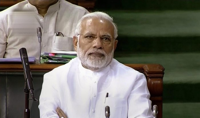 Prime Minister Narendra Modi attends the first day of the Monsoon session of Lok Sabha, at the Parliament in New Delhi on Wednesday. (PTI/TV Grab)
