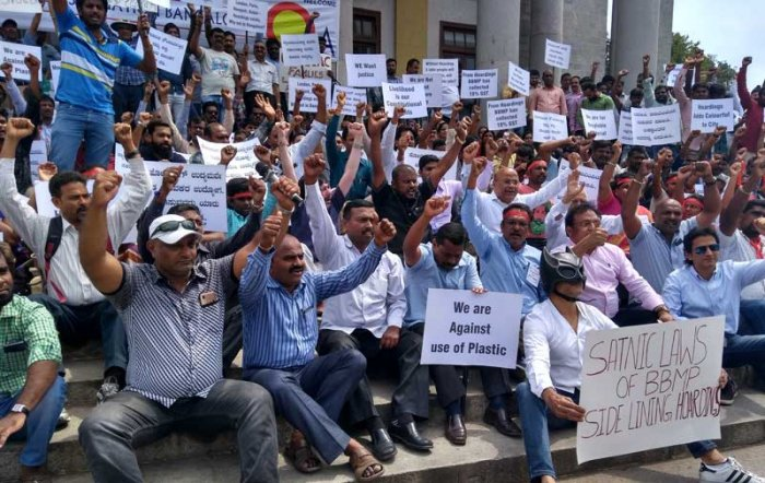 Members of Outdoor Advertising Association stage protest in front of the Town Hall in Bengaluru on Thursday. (DH Photo/Madhuri Rao)