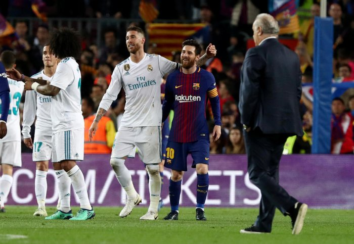 Barcelona's Lionel Messi (right) with Real Madrid's Sergio Ramos at the end of the match. REUTERS