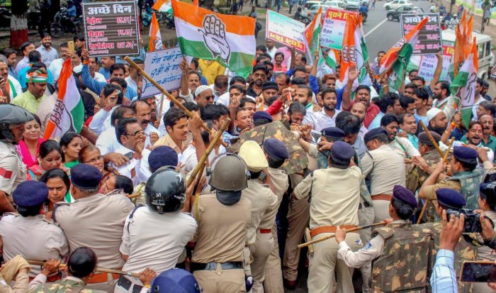 Police stop Madhya Pradesh Congress workers who were holding a demonstration at Raj Bhawan over hike in the prices of diesel, petrol and LPG cylinders, in Bhopal, Friday. PTI