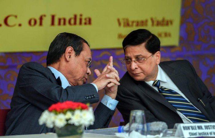 Chief Justice of India Justice Dipak Misra with CJI-designate Justice Ranjan Gogoi during the launch of SCBA Group Life Insurance policy, at the Supreme court lawns, in New Delhi on Tuesday. (PTI Photo)