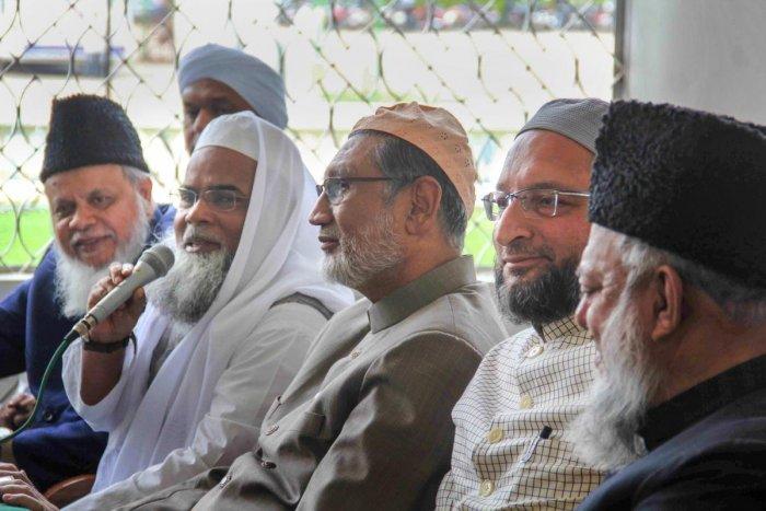 All India Muslim Personal Law Board General Secretary Maulana Khalid Saifullah Rahmani (holding mike), MP Asaduddin Owasis (2nd R) and others address the media on the issue of 'triple talaq' at Darussalam, Hyderabad, Thursday. PTI