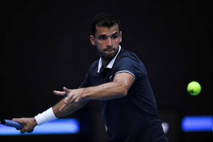 Bulgaria's Grigor Dimitrov returns to Tennys Sandgren of the US during their men's singles match on Tuesday. AFP