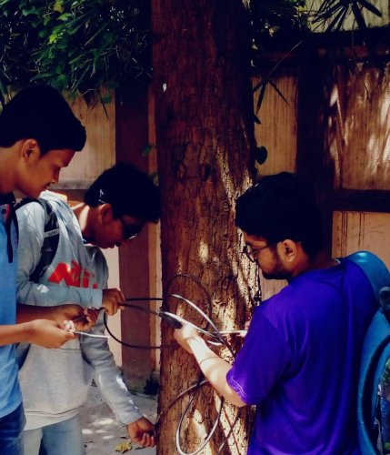 Volunteers clear illegal cables in J P Nagar 1st Phase.
