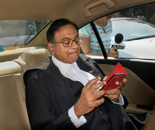 Former union minister P Chidambaram leaves the Patiala High Courts after a hearing in the INX media case in New Delhi on Oct 25, 2018. The Delhi High Court has extended interim protection to Chidambaram in the case till Nov. 29. Credit: PTI photo