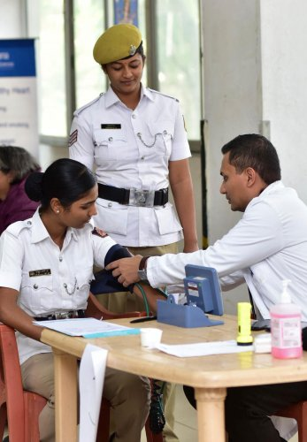 In a gesture to convey their gratitude for the cops' support, the residents of the city organised a free health camp for the traffic cops in Indiranagar. (DH Photo)
