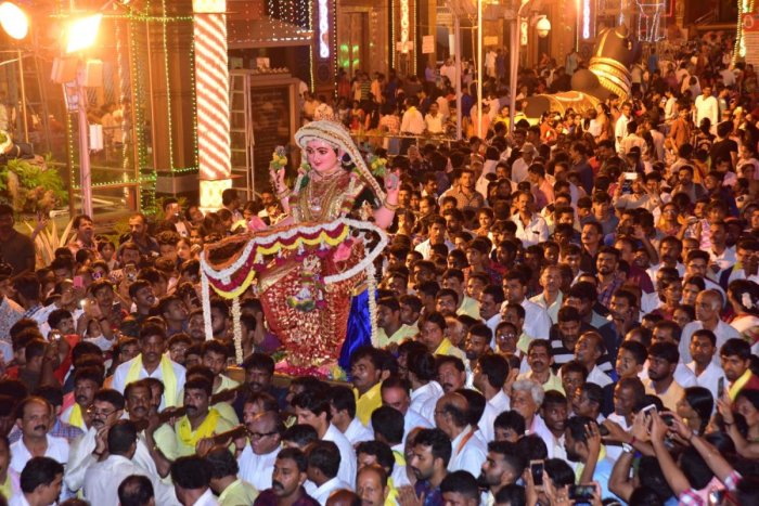 The idol of Goddess Sharada being carried by devotees to the tableau parked outside Kudroli Sri Gokarnanatha temple in Kudroli on Friday evening.