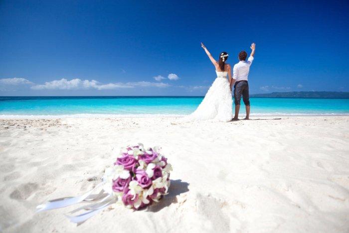 A newly wed couple on the beach