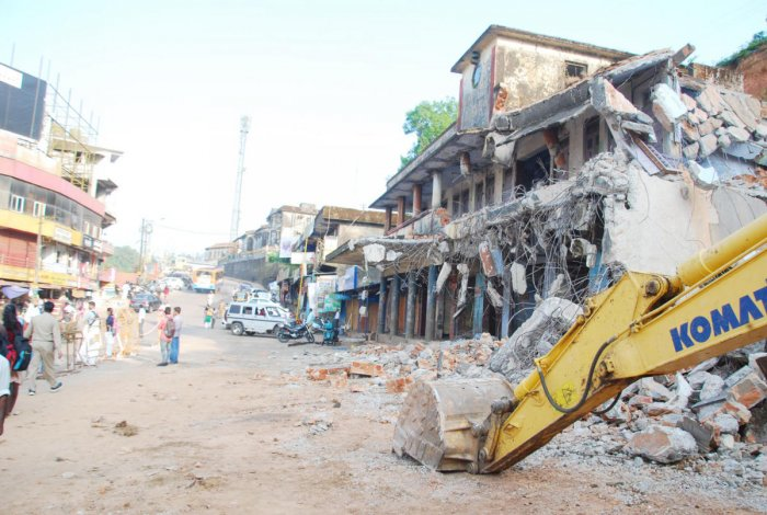 The old private bus stand of Madikeri being demolished.