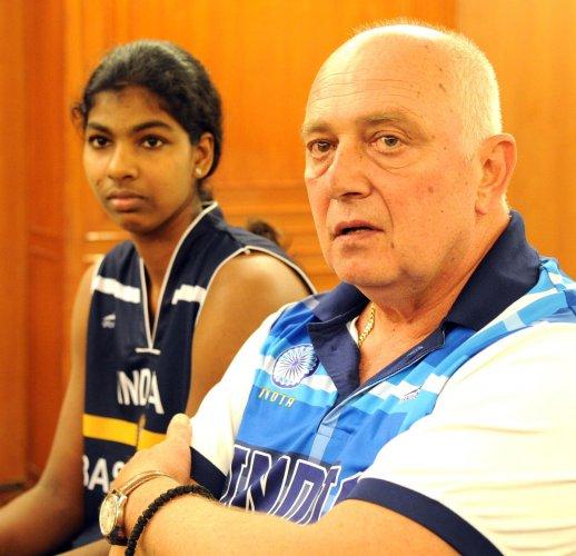 HOPEFUL Indian coach Zoran Visic addresses the media as captain Pushpa Senthil Kumar looks on. DH Photo