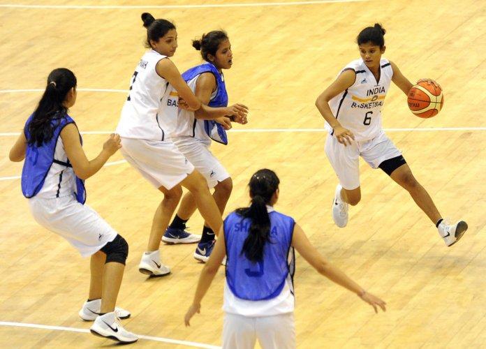 GEARING UP Indian basketball players during a training session at the Koramangala Indoor Stadium on Saturday. DH PHOTO/ Srikanta Sharma R