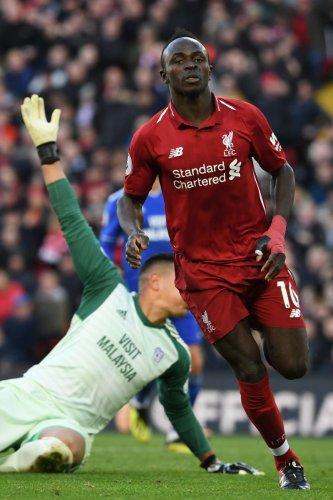 Liverpool's Sadio Mane celebrates after scoring against Cardiff City. AFP