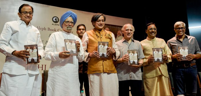 """Former prime minister Manmohan Singh, Congress leader P Chidambaram, former Union minister Arun Shourie, former diplomat Pavan Verma and former jounalist Ashutosh at the release the book """"Paradoxical Prime Minister"""" authored by Shashi Throor (3rd from left) in New Delhi, Friday. PTI"""
