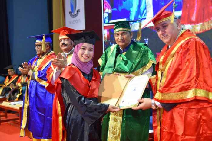 A student receives degree from All India Institute of Medical Sciences, Jodhpur Director and CEO Dr Sanjeev Misra during the convocation of Yenepoya Deemed to be University, at Deralakatte on Saturday.
