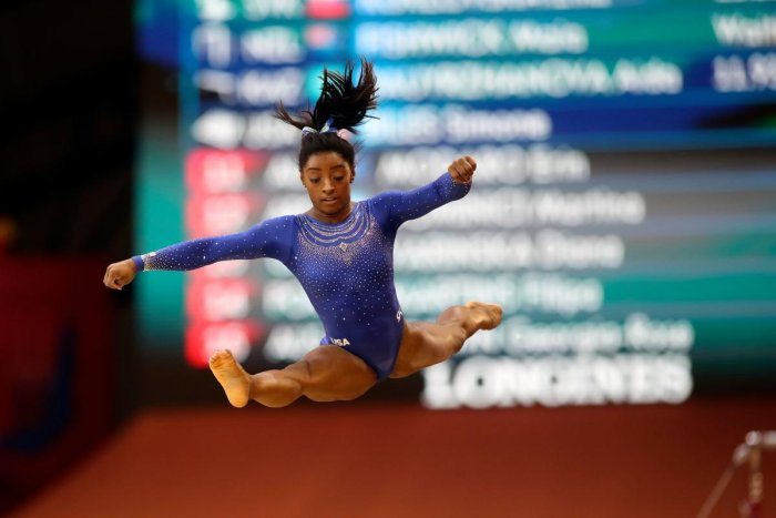 INSPIRING: Simone Biles of the US competes in the women's floor qualification of the Artistic Gymnastics Championship in Doha on Saturday. AFP