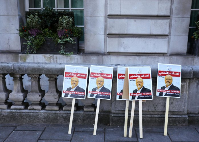 Placards can be seen outside the Saudi Arabian Embassy in London as people protest against the killing of journalist Jamal Khashoggi in Turkey. (Reuters Photo)