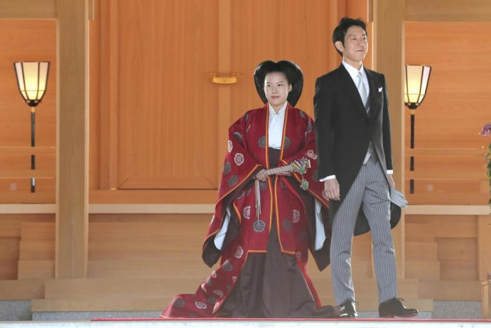 Japanese Princess Ayako (L) and her husband Kei Moriya are pictured after their wedding ceremony at the Meiji Shrine in Tokyo, Japan, in this photo released by Kyodo on October 29, 2018. (Kyodo/via REUTERS)