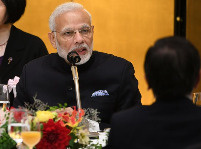 Indian Prime Minister Narendra Modi delivers a speech while attending a luncheon hosted by the Keidanren at a Tokyo hotel on October 29, 2018. (Photo by Toshifumi KITAMURA / AFP)